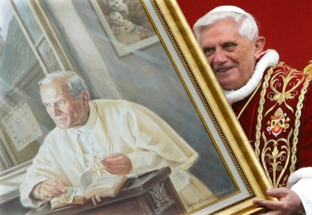 File photo of Pope Benedict XVI's holding a portrait of late Pope John Paul II during a meeting with the faithful at Wadowice
